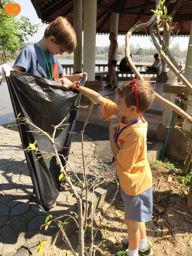 Panyaden primary students picking up litter at Huay Tung Tao Chiang Mai as part of their social contribution