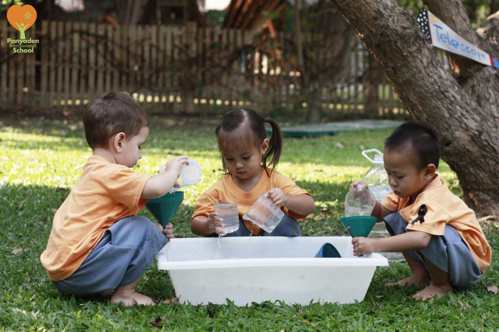 Panyaden nursery measuring water for Panyaden Preschool Festival of Learning