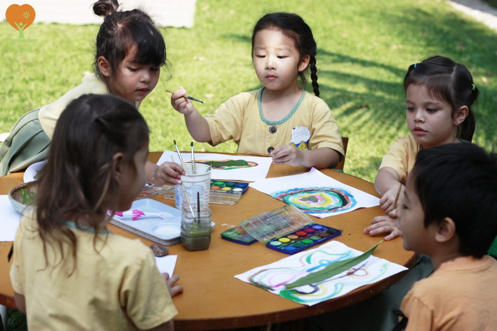 Panyaden's preschoolers painting outdoors at school, Festival of Learning