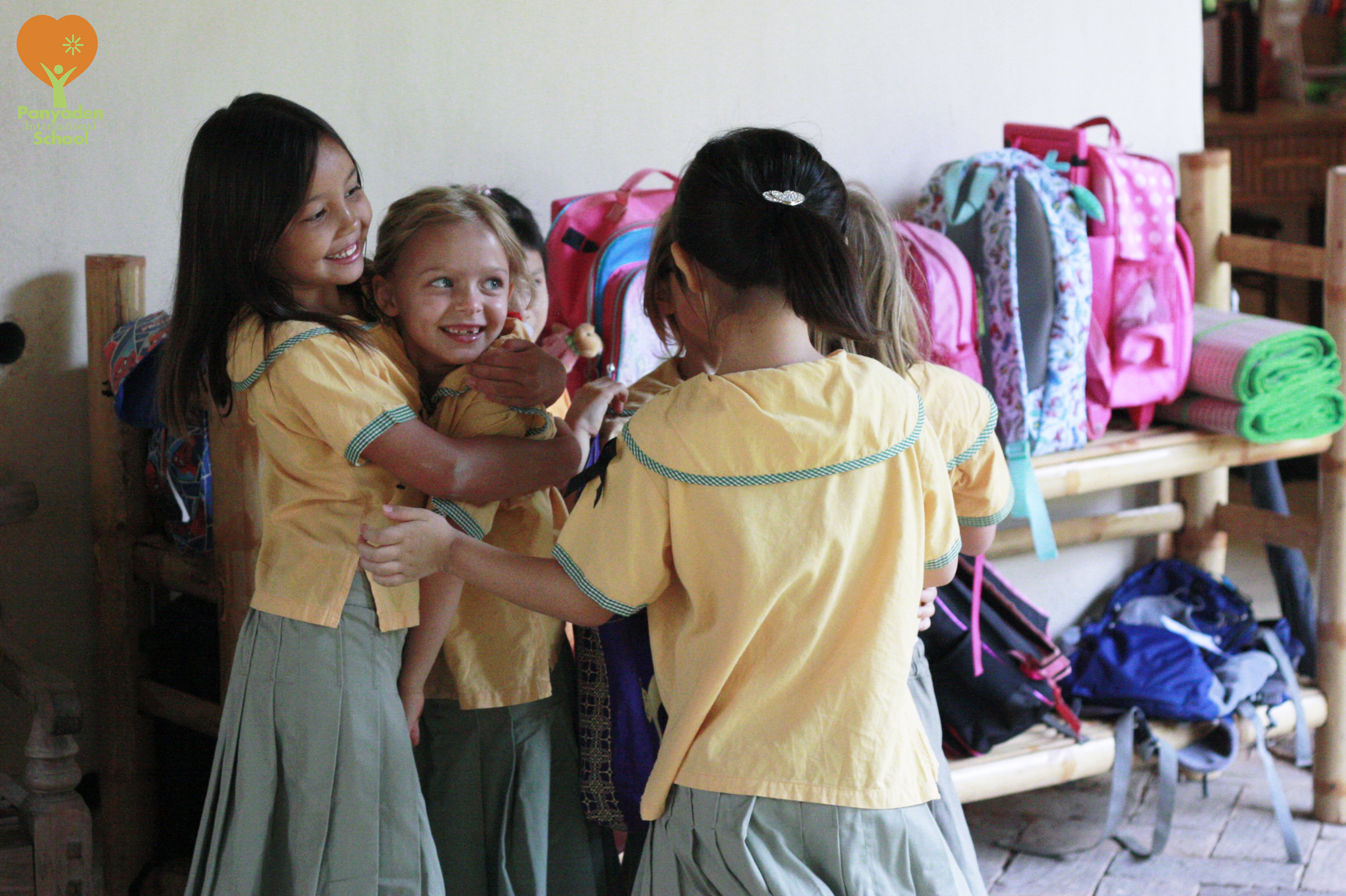 Students hugging friends, happy to be back at Panyaden International School