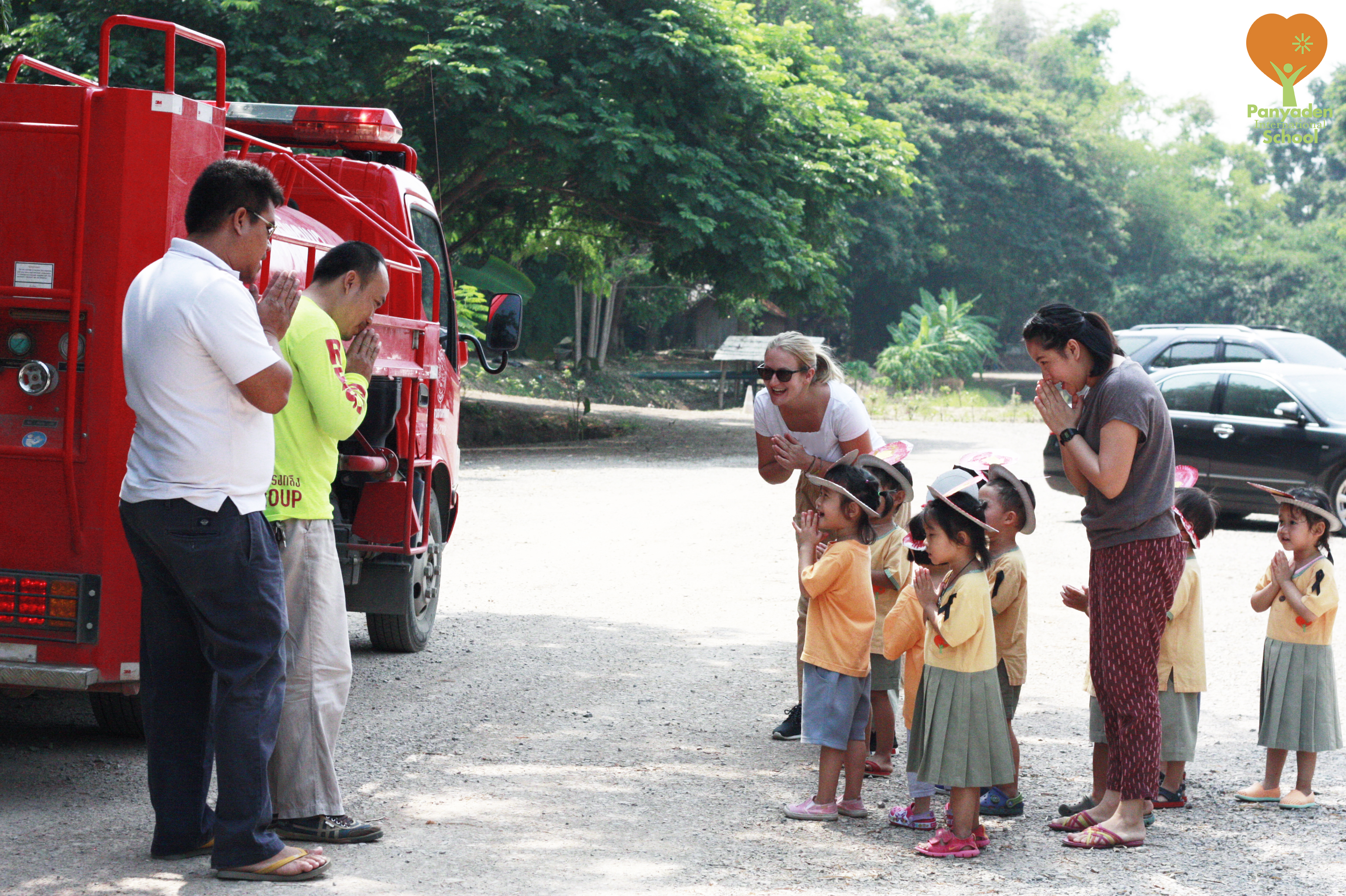Panyaden Nursery children wai fire station representatives