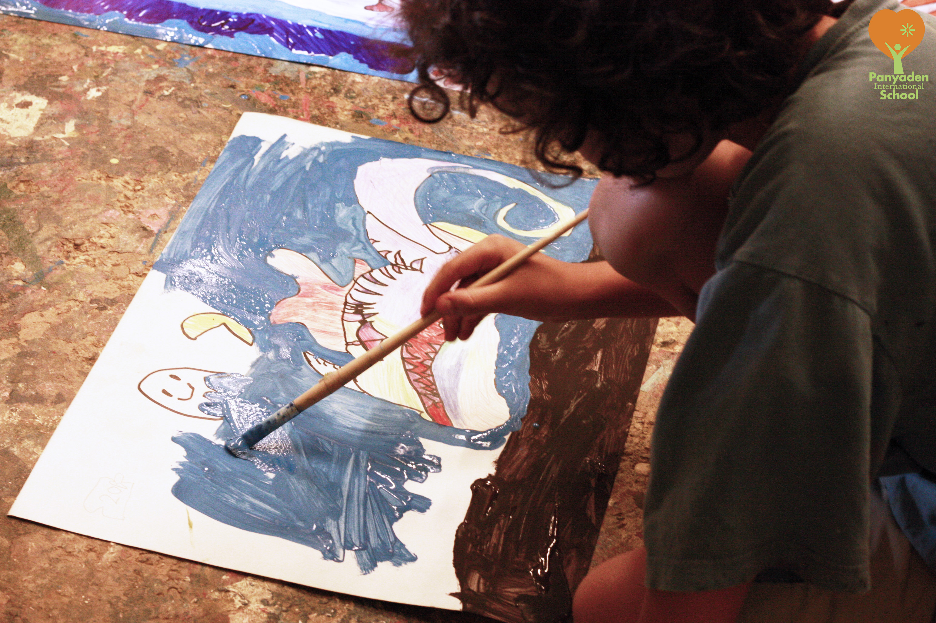 Panyaden Year 1 student working on his paintings