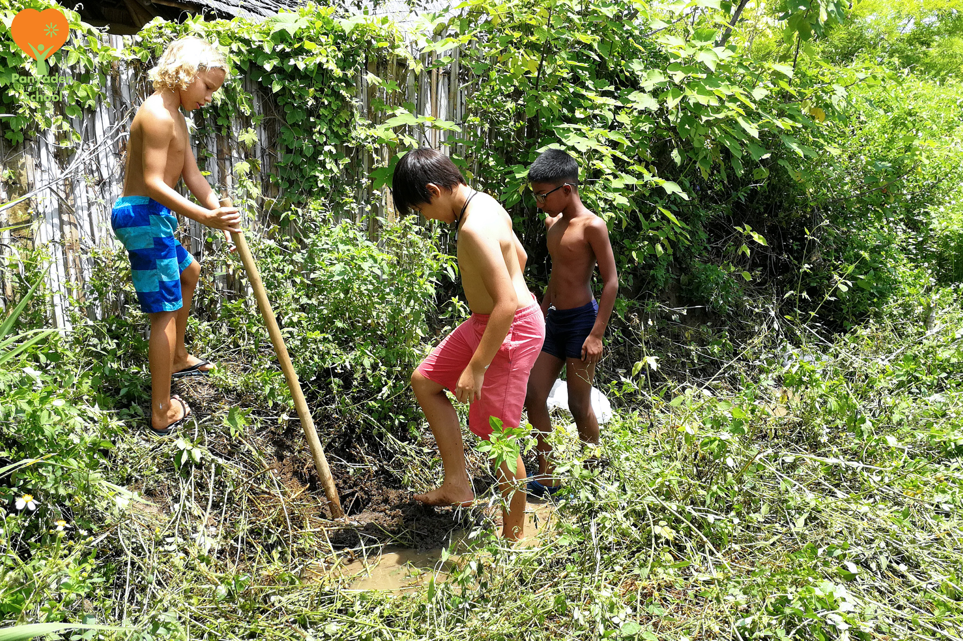 Panyaden Year 6 boys help the school maintenance staff patch holes in the school field after heavy rains 2