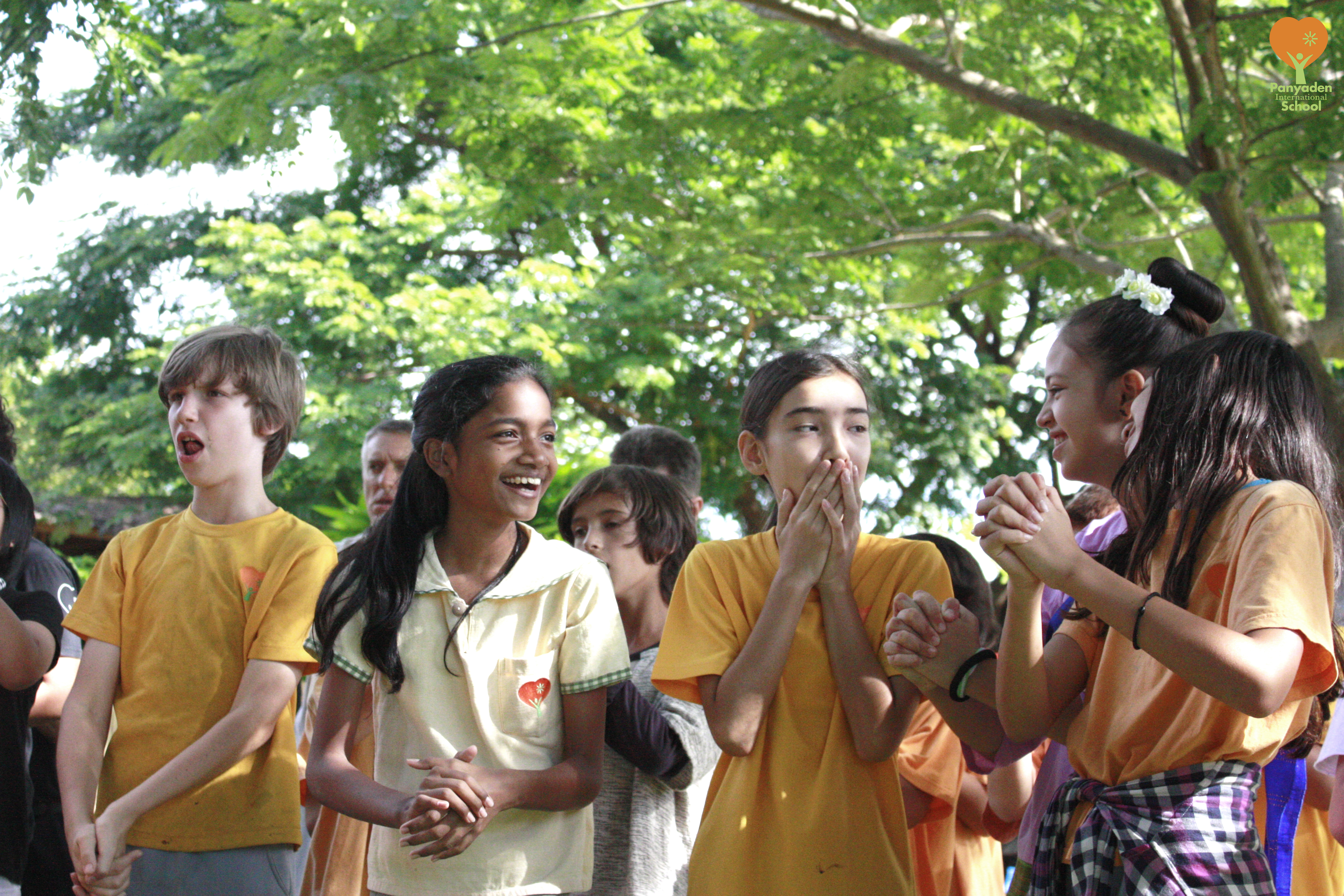 Panyaden Upper Primary students enjoy a laugh before Blossom Day show