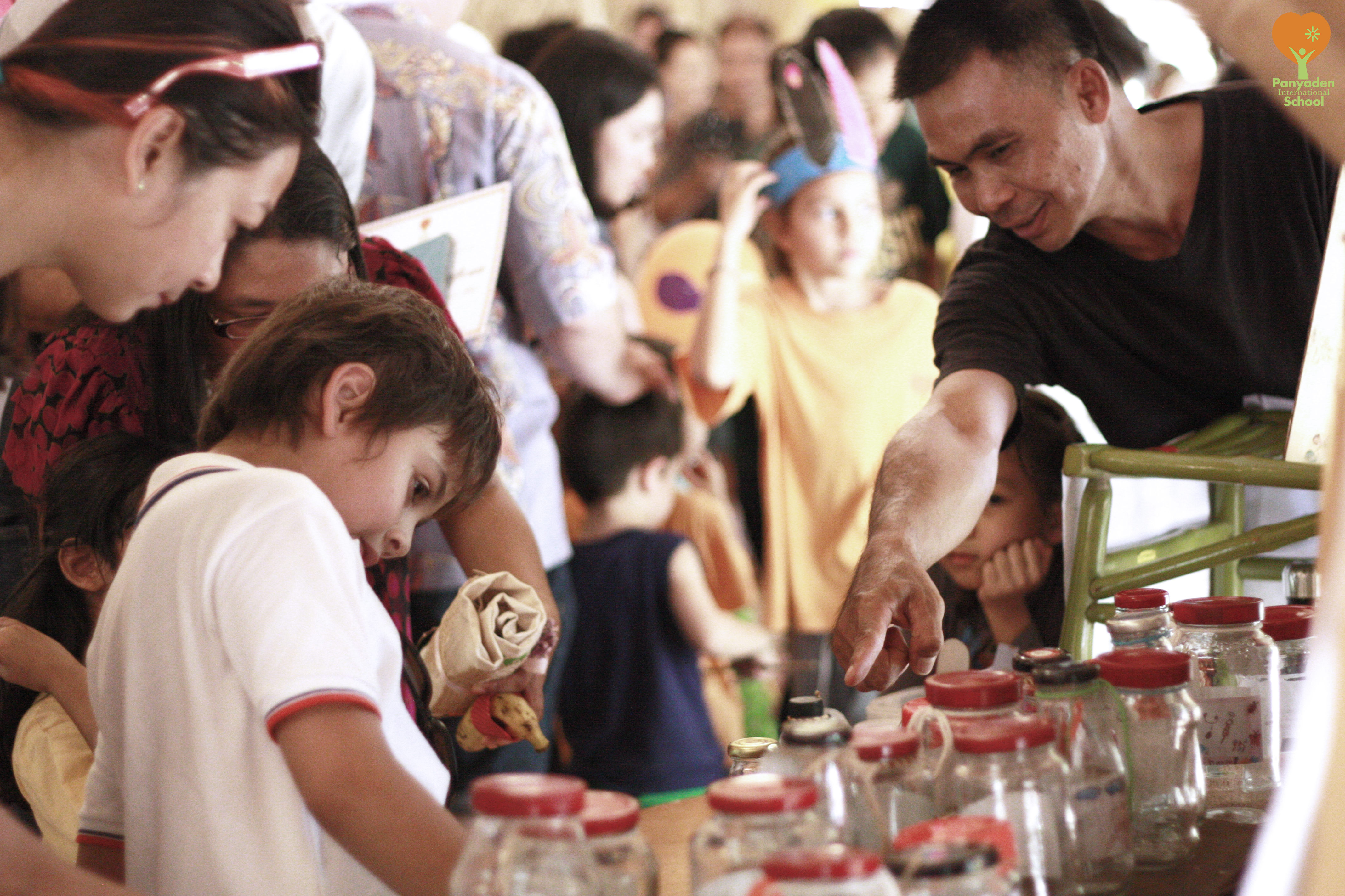 Panyaden student manning stall at Panyaden Blossom Market