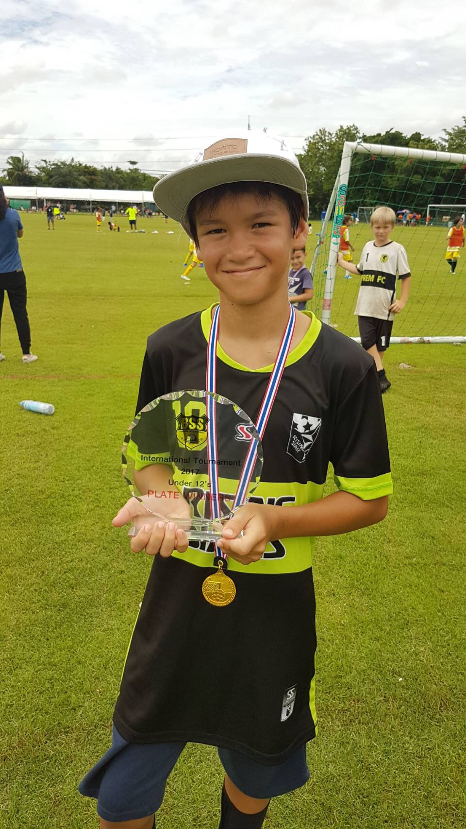 Panyaden student Din with his soccer medal
