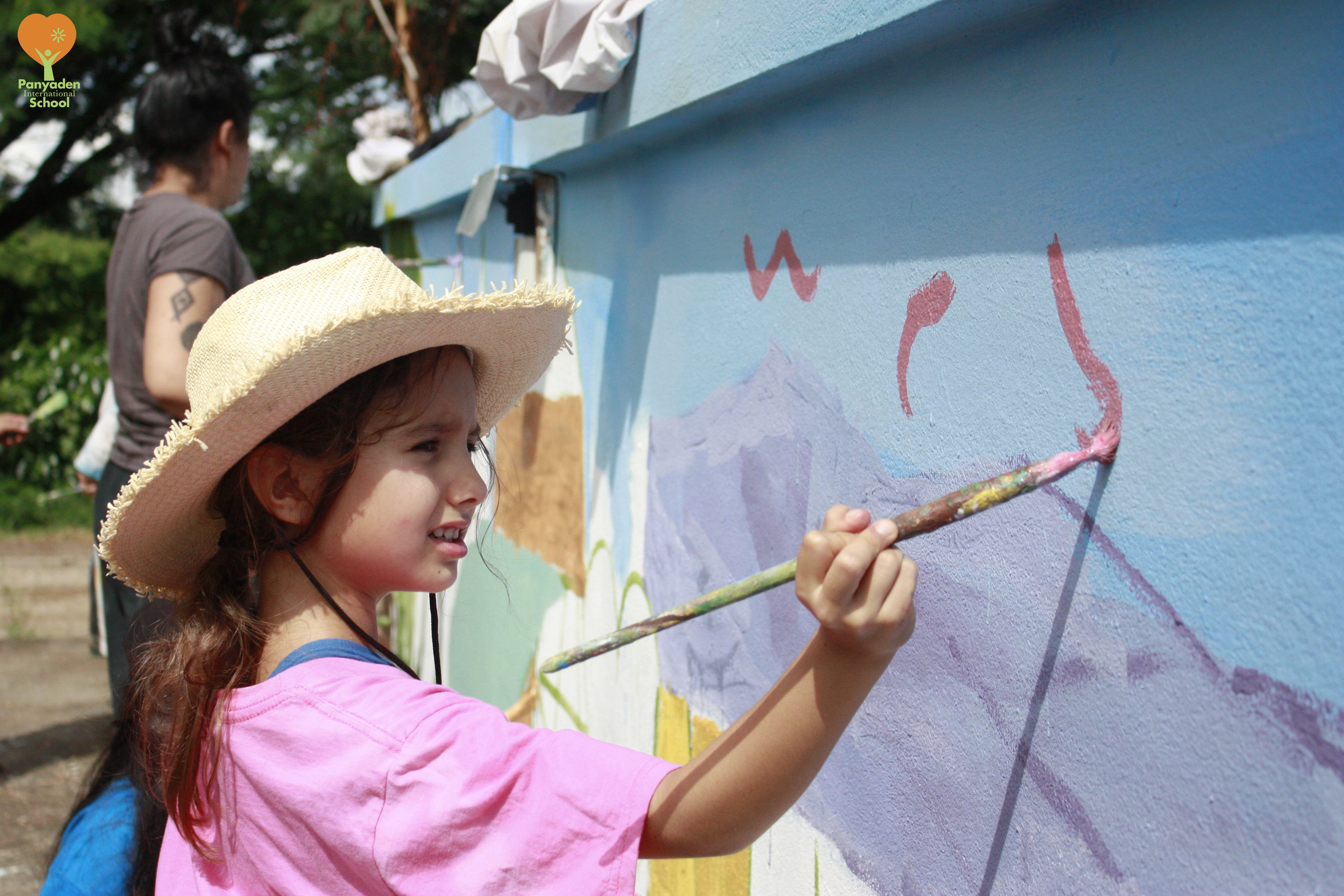 Panyaden Year 3 (Y3) student contrates on painting mural