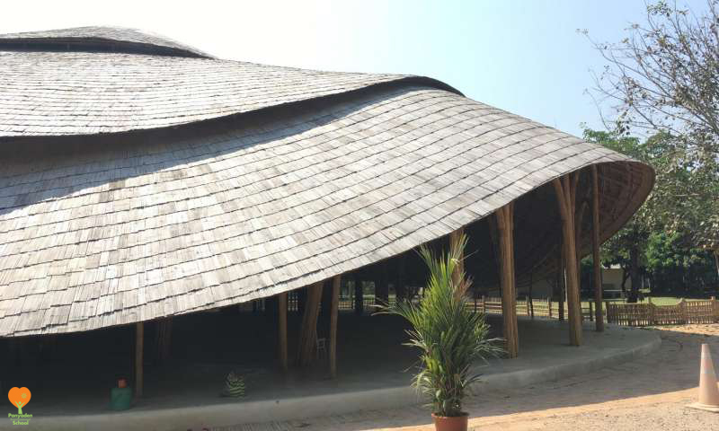 Panyaden bamboo sports hall side view by Chiangmai Life Architects