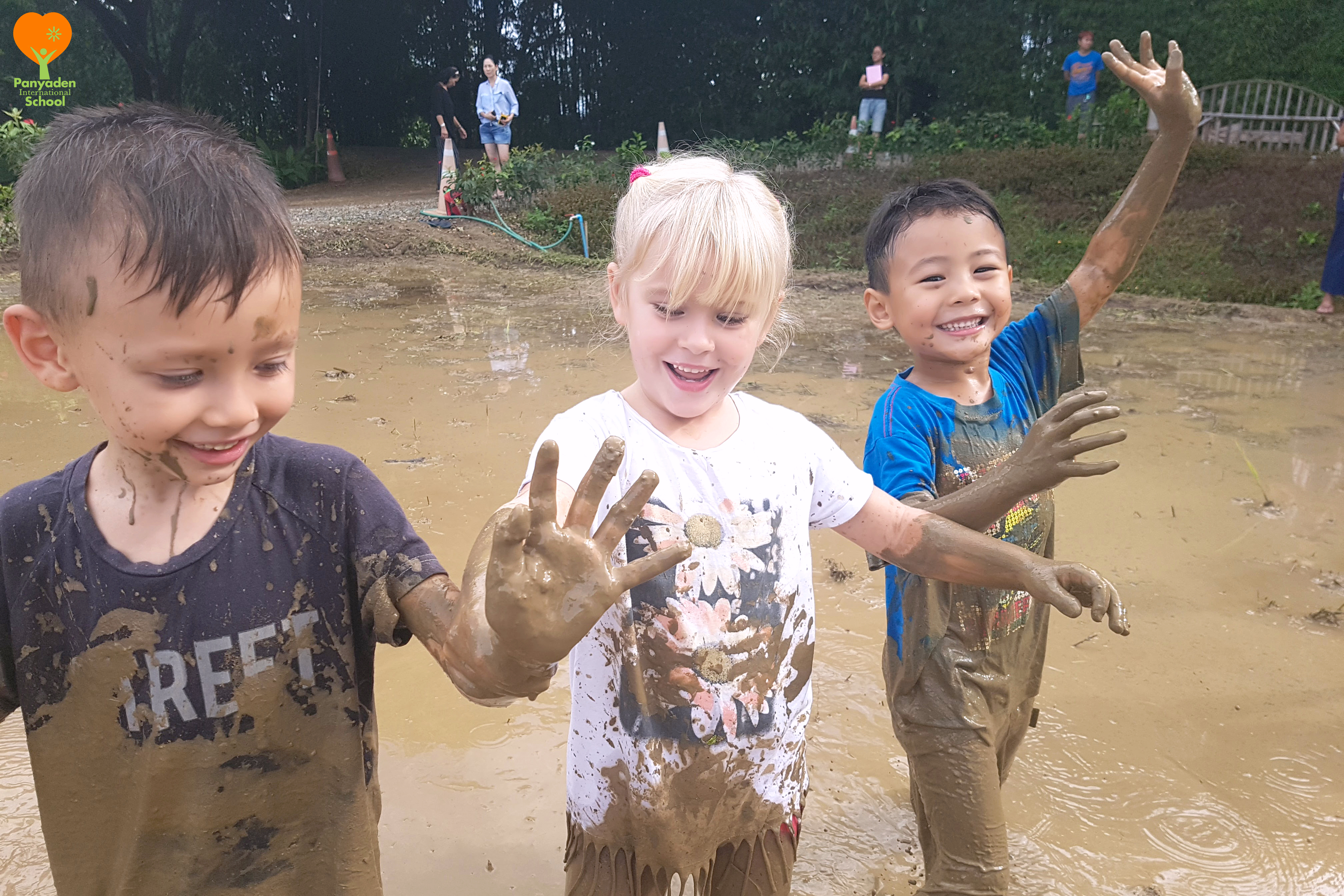 DHappy students dancing in the mud, Panyaden Rice Planting Day
