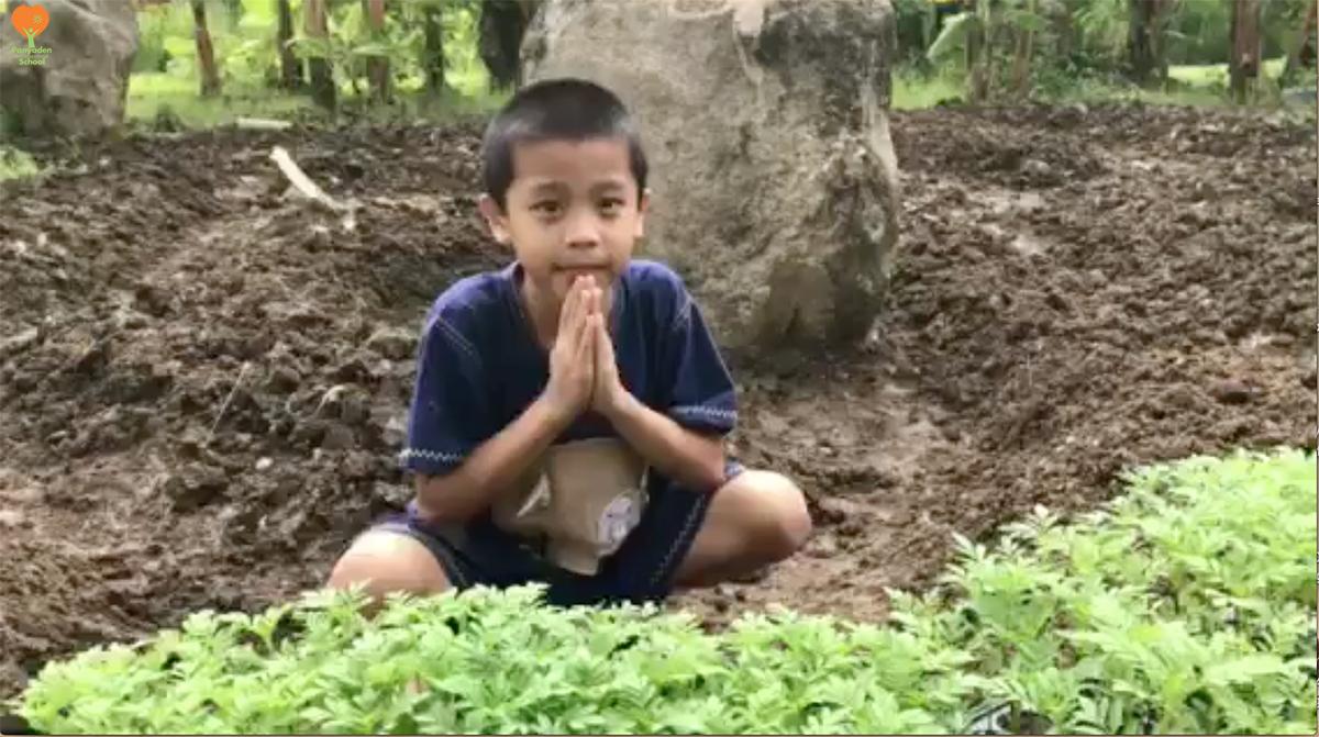 PStudent planting marigolds in rememberance of King Rama IX, Panyaden International