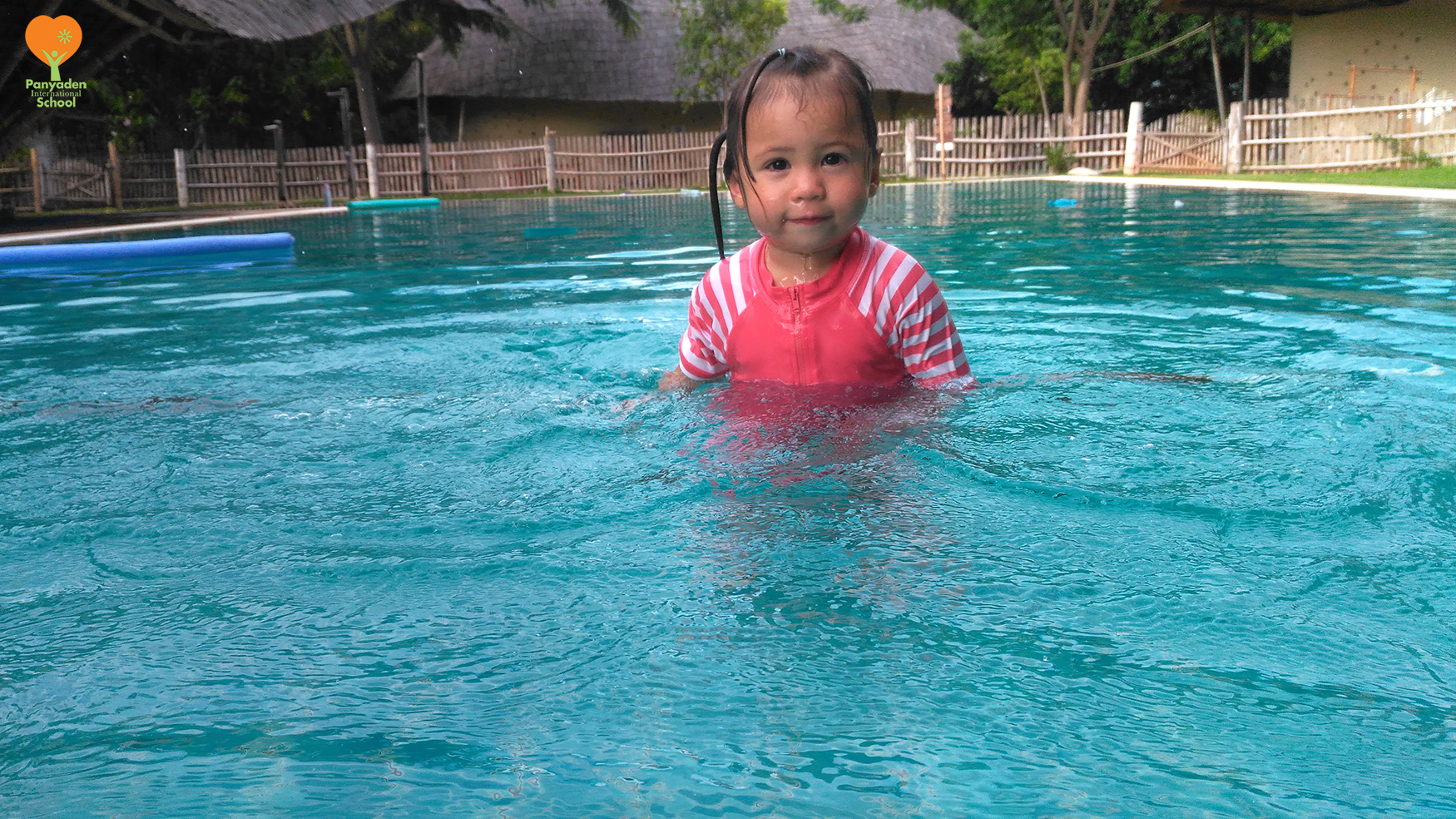 Becoming friends with teh water. Panyaden nursery student at afterschool swim club