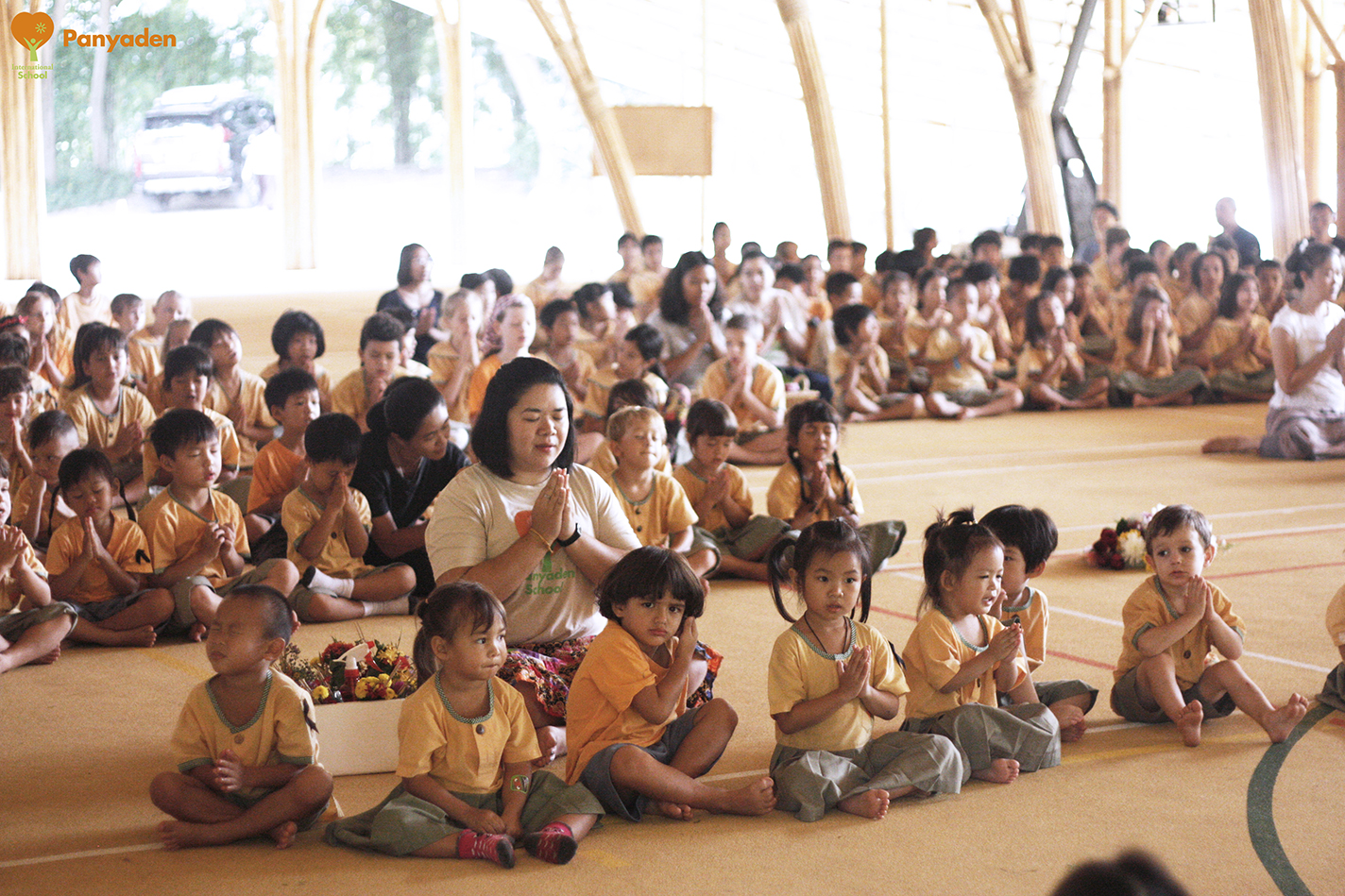 Panyaden Wai Kru Day 2017 - students paying respects in the school bamboo Sports Hall