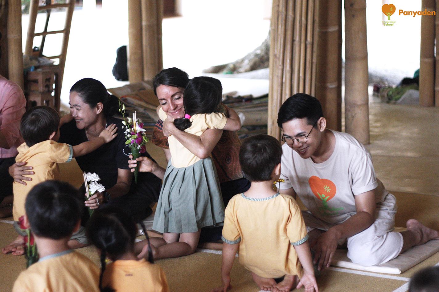 Panyaden Wai Kru Day 2017 ceremony - hugs and flowers for teachers