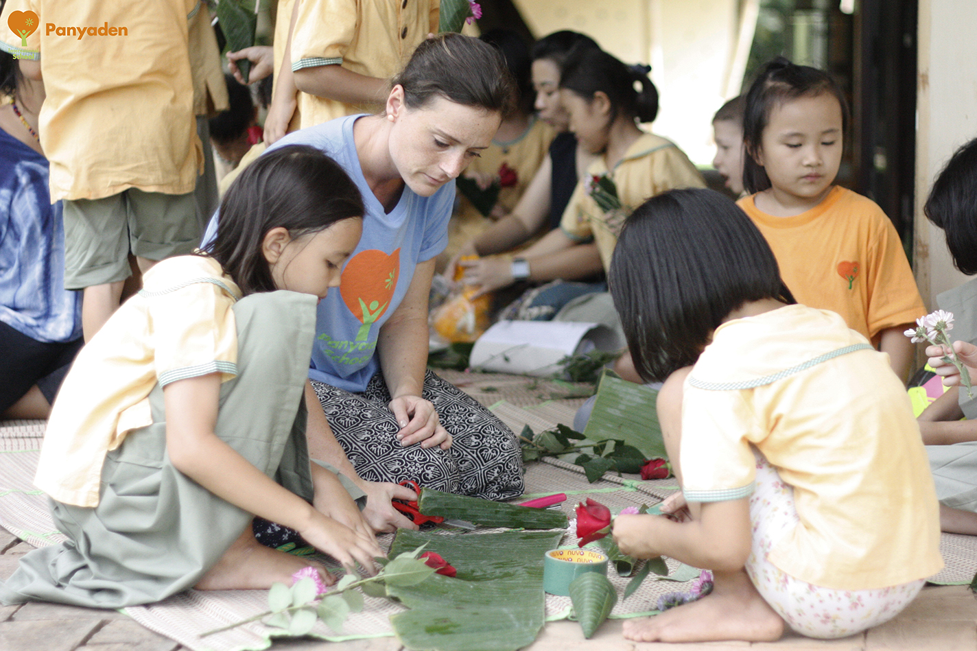Panyaden Wai Kru Day 2017 preparation - Panyaden primary students cutting up banana leaves for flowers