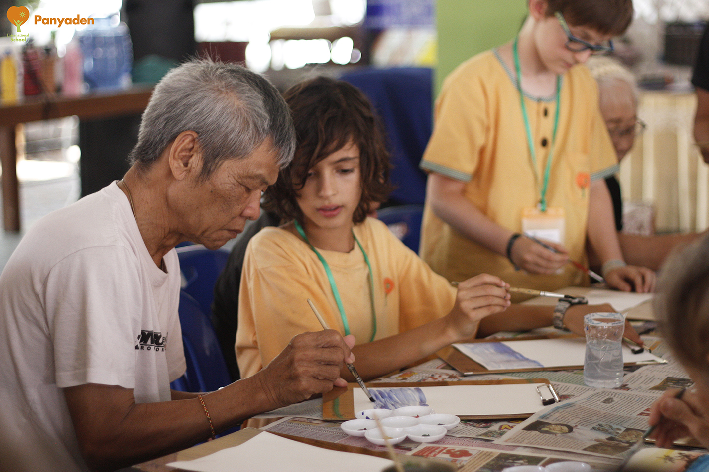 Panyaden Social Contribution Day: Primary student painting with elderly at elder aId home in Chiang Mai