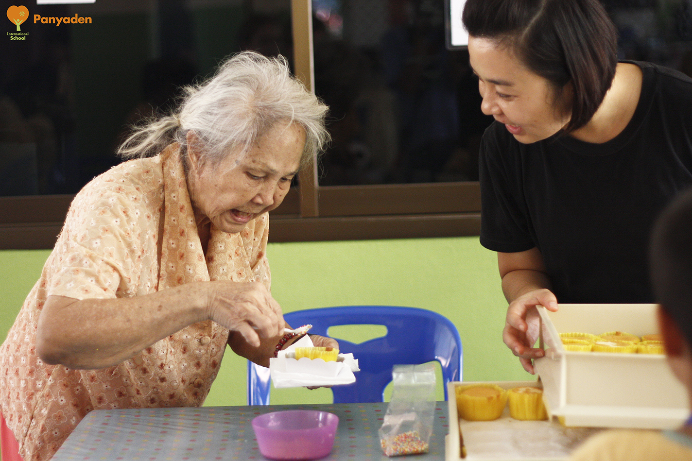 Panyaden Social Contribution Day: Panyaden teacher with elderly resident at elder aId home in Chiang Mai
