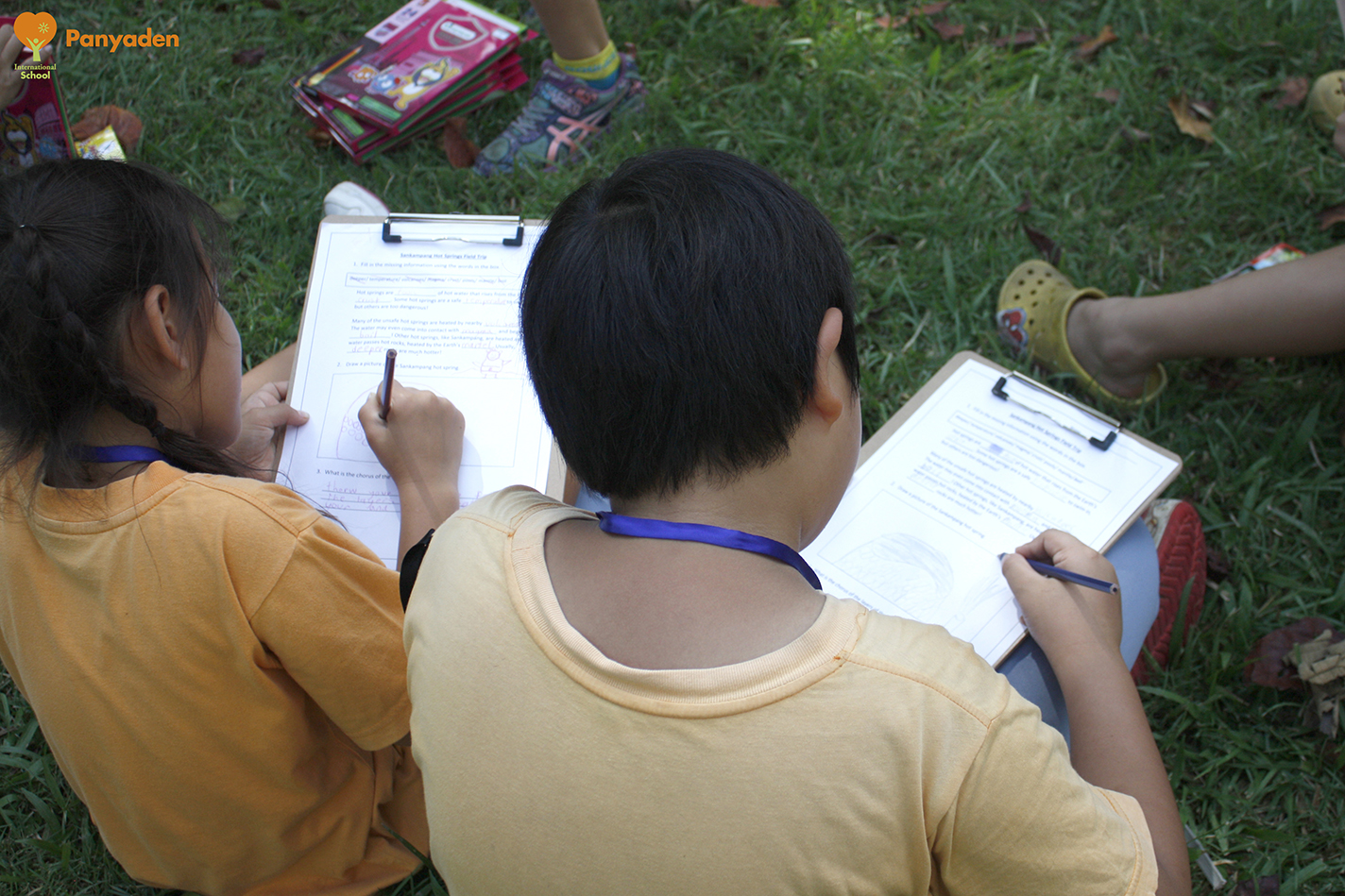 Panyaden Year 4 field trip - students writing down what they have learnt