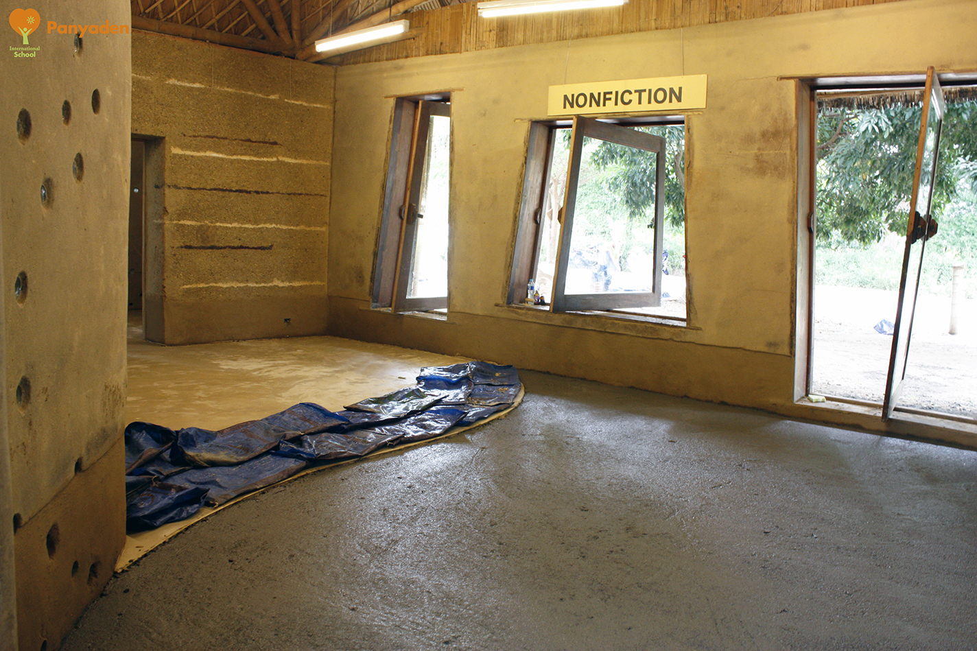 New rammed earth floor for Panyaden