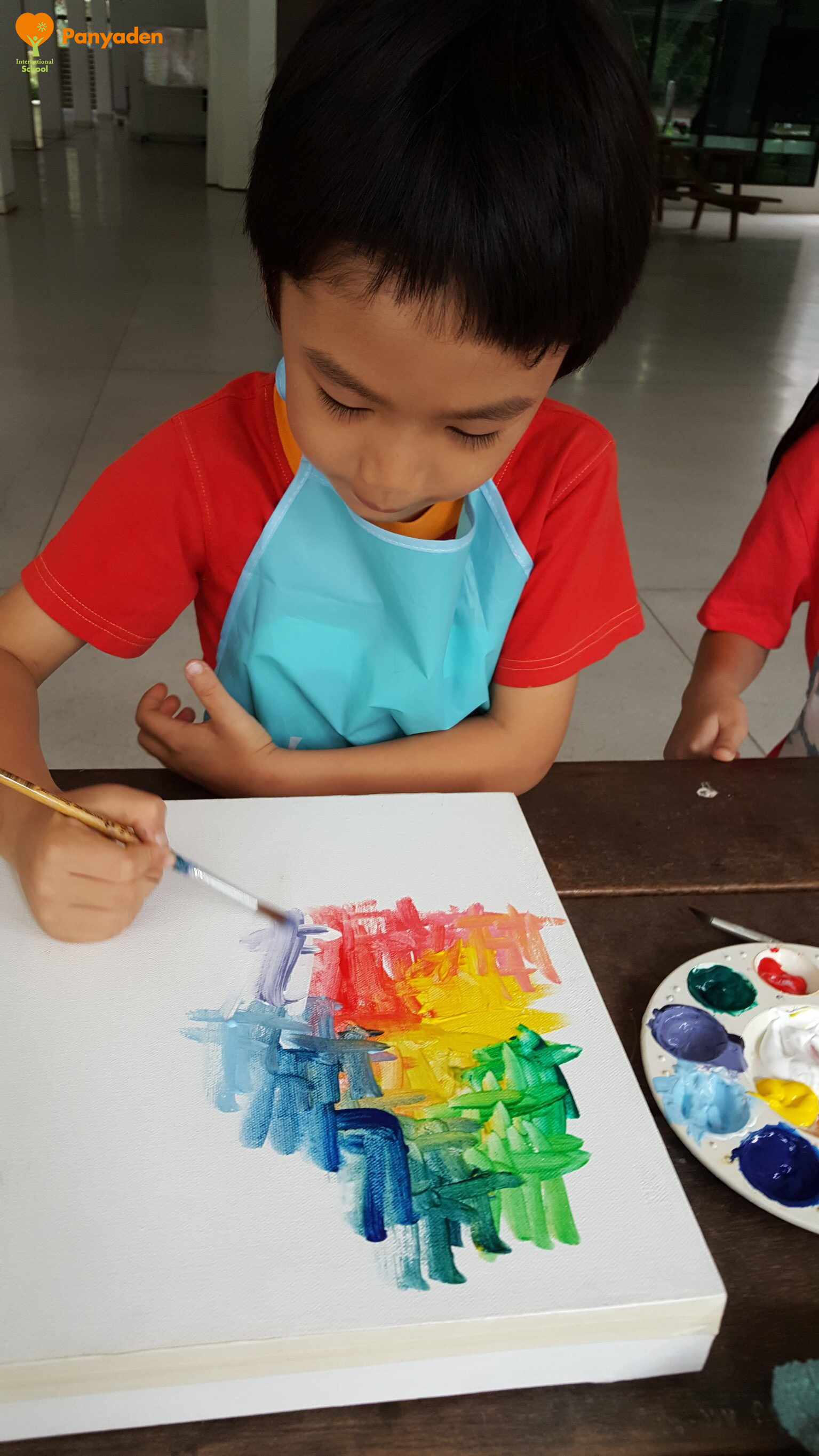 Rebuilding Panyaden: Y2 student painting for his art auction