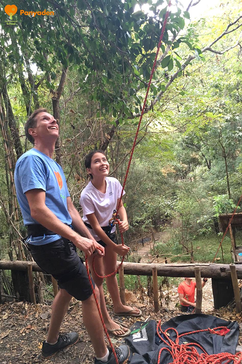 Panyaden Y7 rock climbing - teacher with student