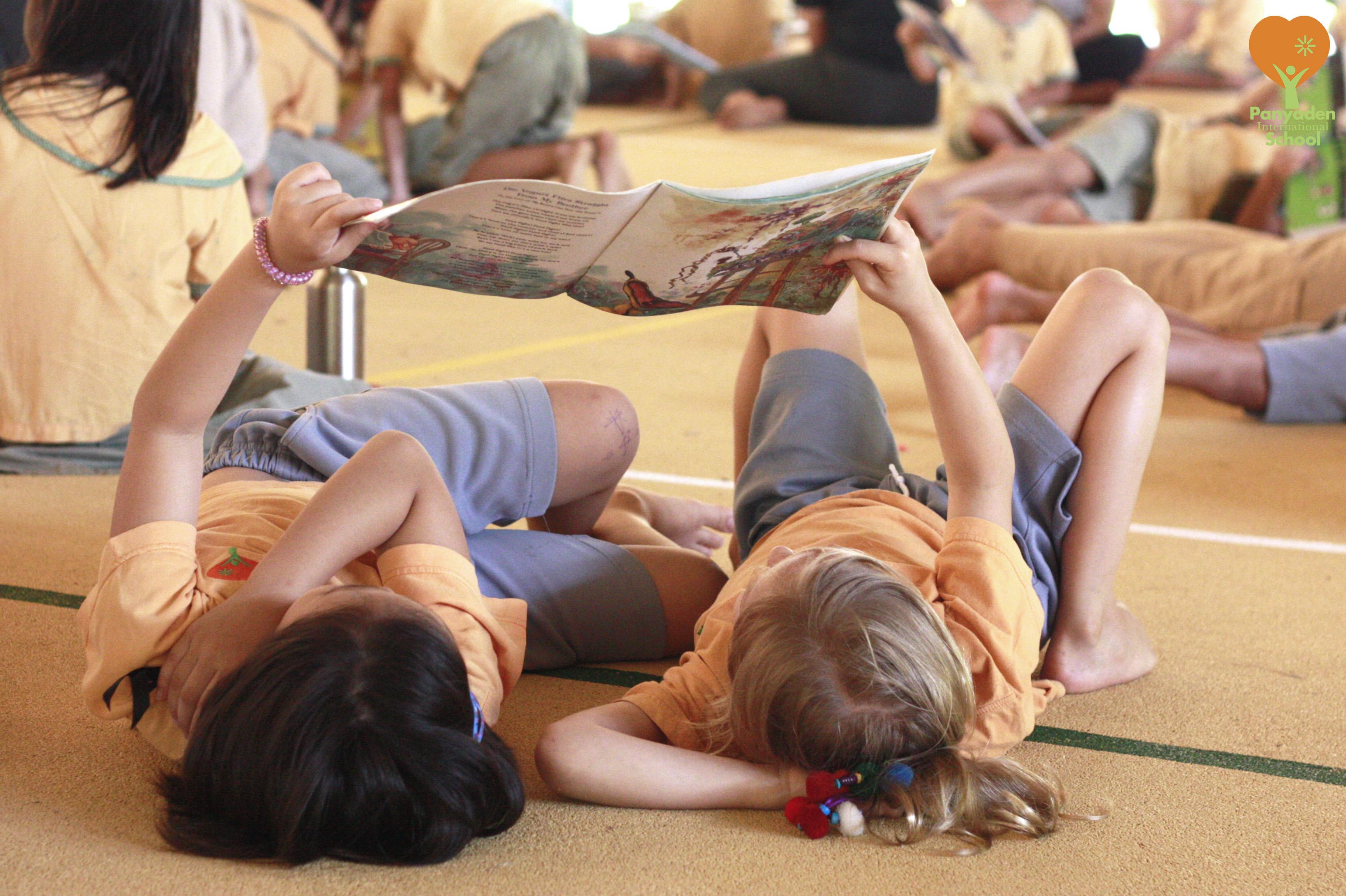We love reading! Students enjoying book at Panyaden
