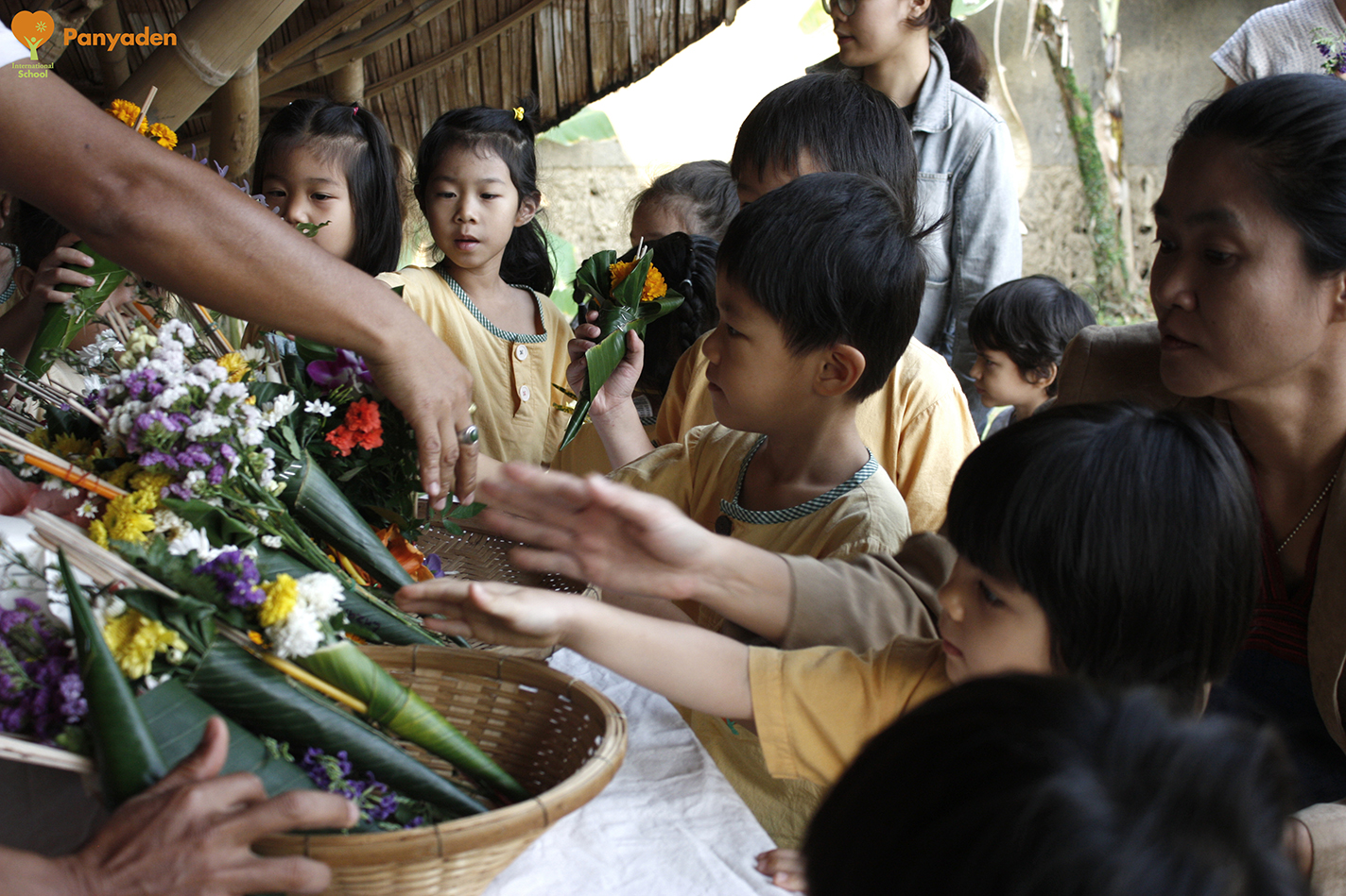 Panyaden students placing offerings at school's Buddha Sala as part of Makha Bucha Day 2018 celebrations