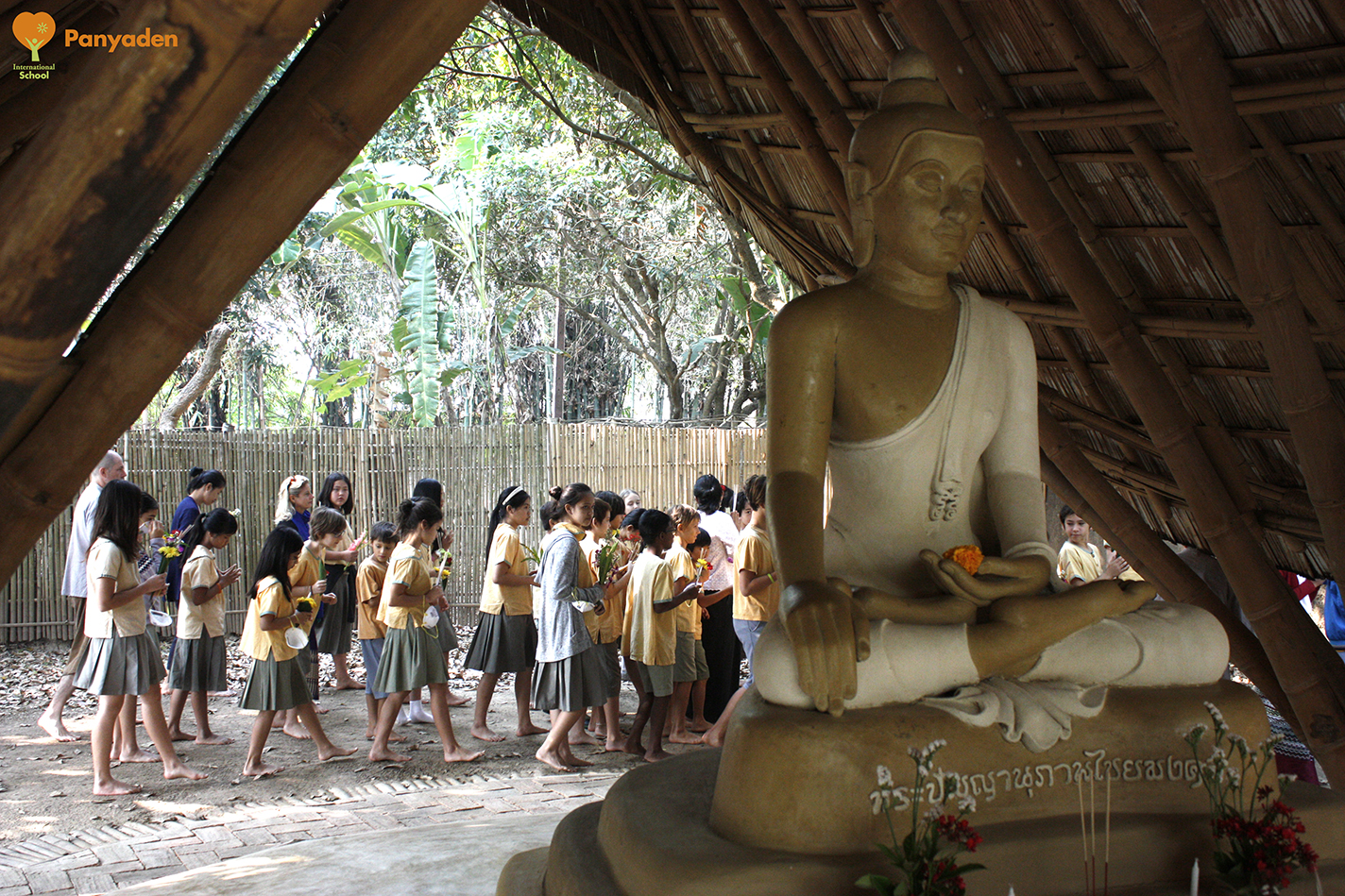 Panyaden students and staff circumbulate the school's Buddha Sala as part of Makha Bucha Day 2018 celebrations