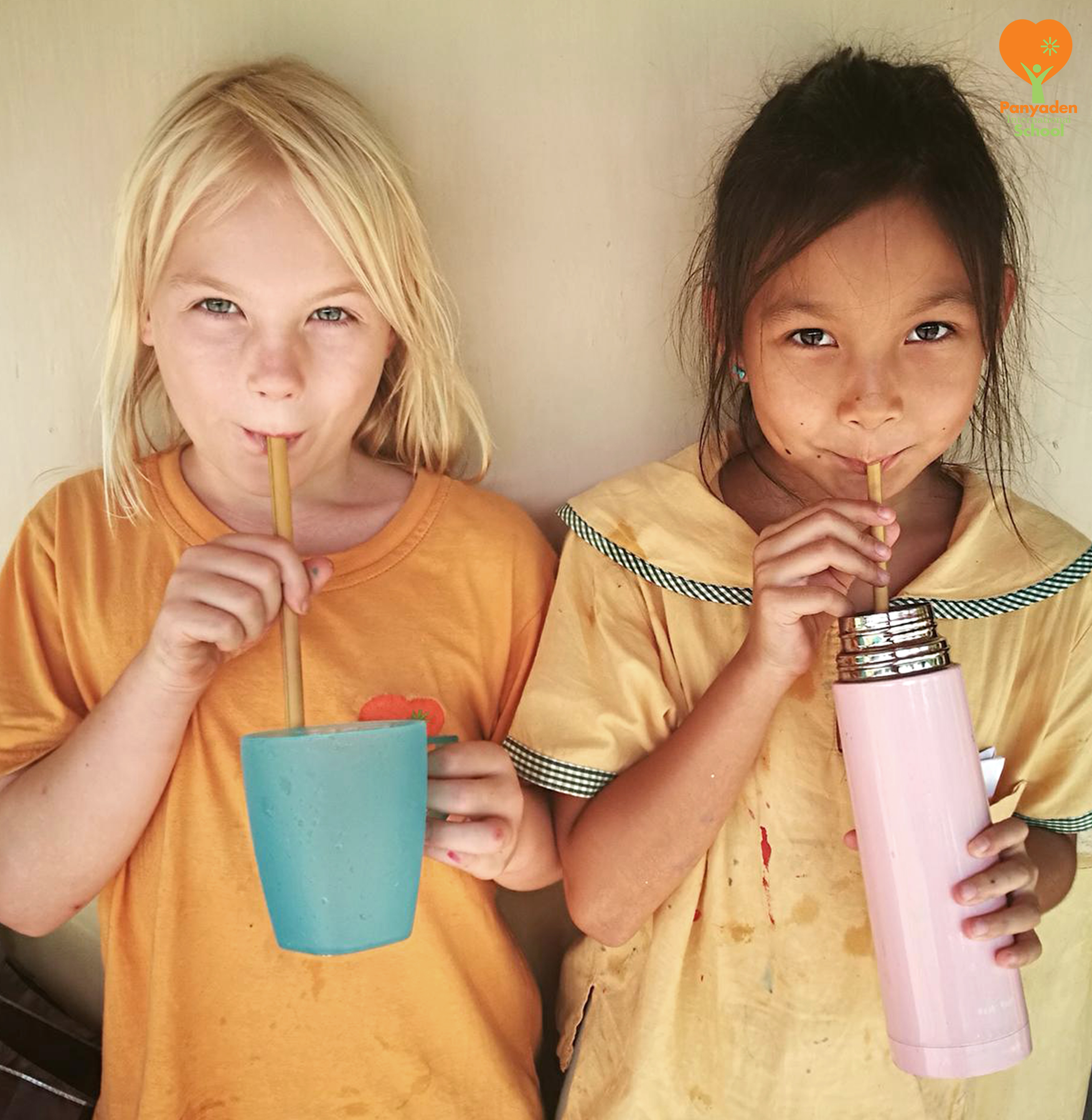 Panyaden Year 3 students drinking with the bamboo straws they made