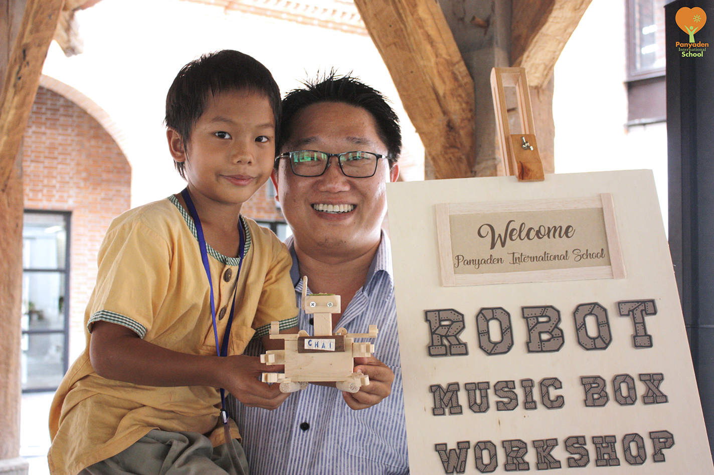 Panyaden Year 3 music box workshop - student with owner of studio